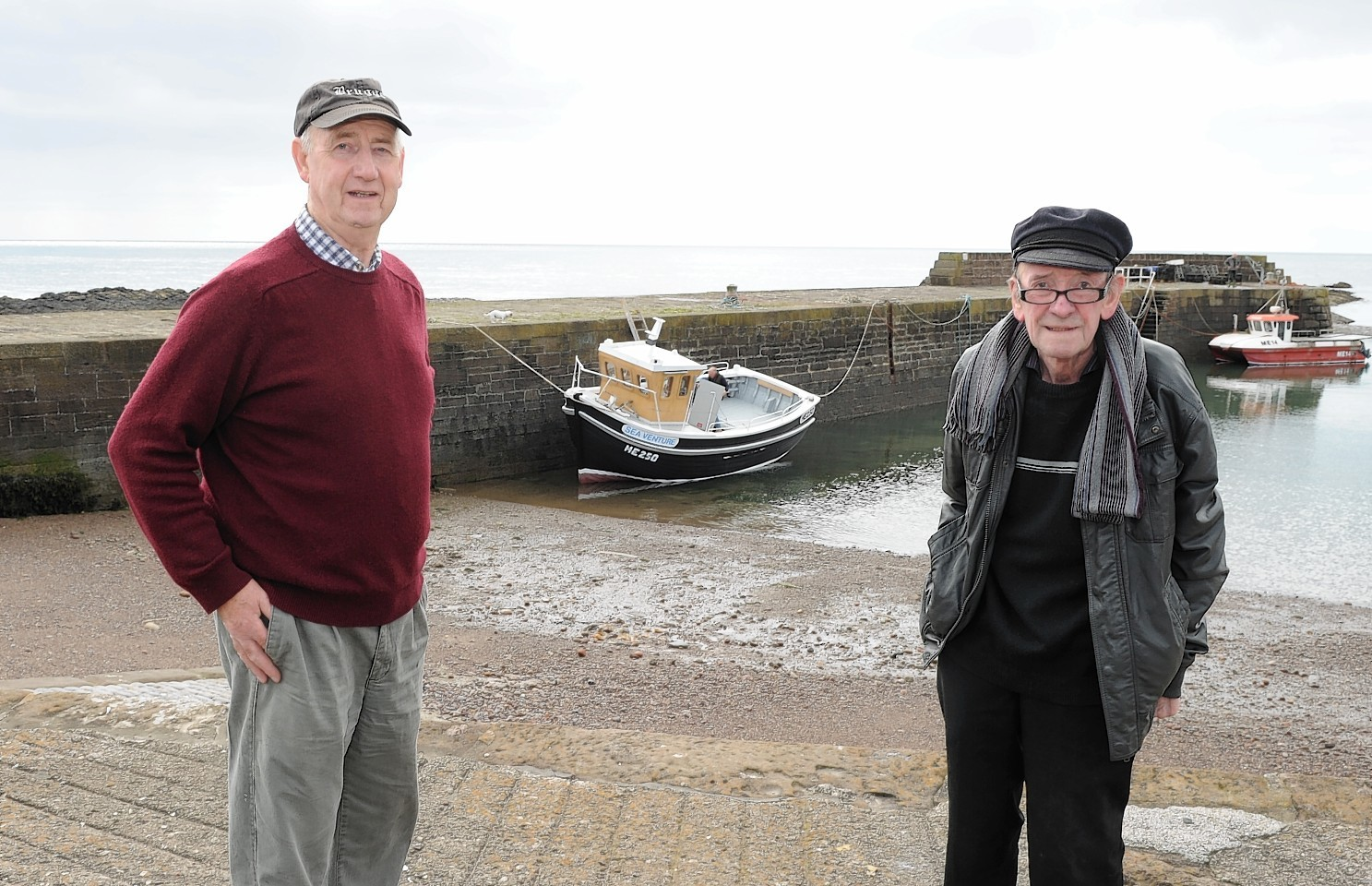 Johnshaven  man Tom Ritchie and Richard McBay with the Sea Venture for the first time in the water. Picture by COLIN RENNIE
