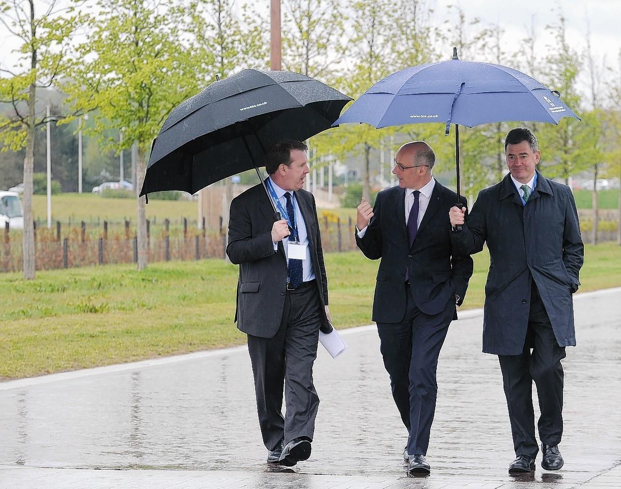 John Swinney, Alex Paterson and Lorne Crerar walk through the Inverness Campus