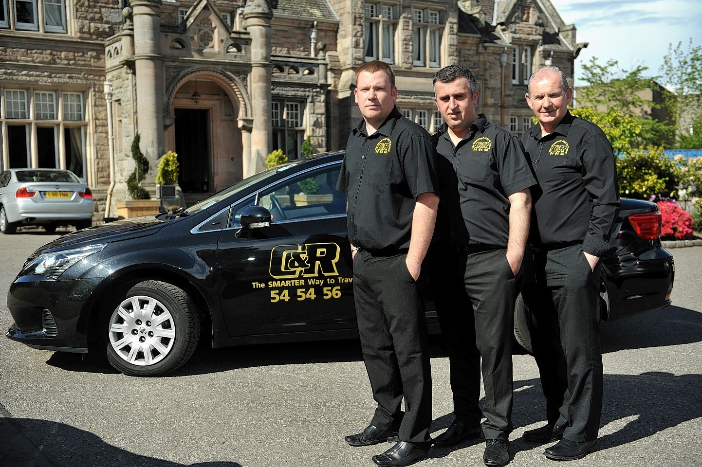 C&R Taxi drivers of Elgin, in their uniforms.