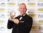 Manager John Hughes collects the PFA Scotland Manager of the Year award