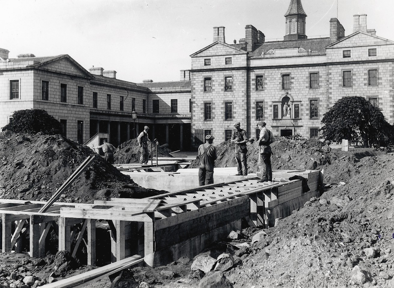 Workmen construct air raid shelters in the grounds of Robert Gordon's College.