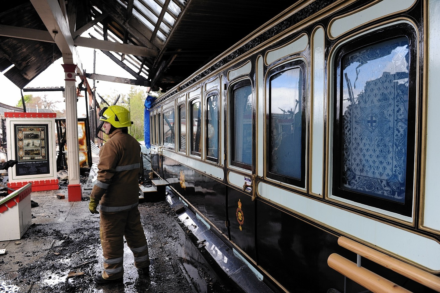 Firefighters managed to save the £450,000 replica of Queen Victoria's royal carriage