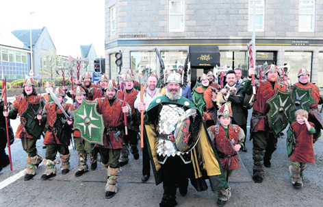 Guizer Jarl Neil Robertson with his squad of Vikings outside Skene House, Aberdeen