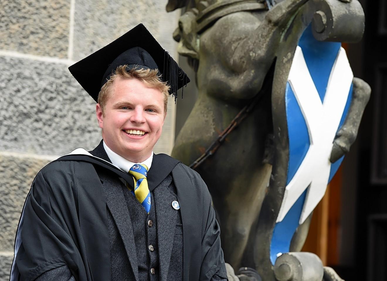 Andrew Mustard celebrates graduating. Picture by Jim Irvine