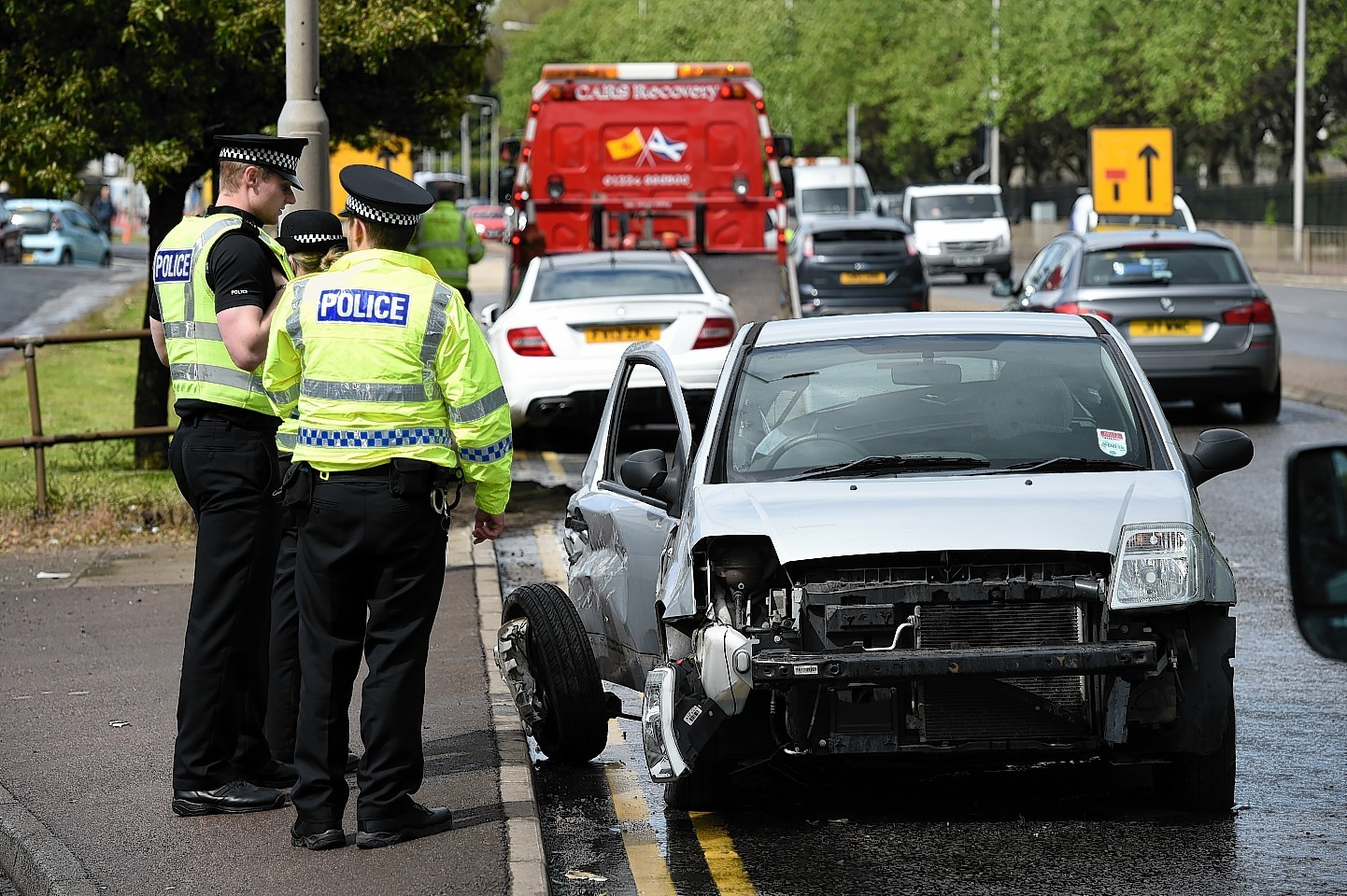Police Scotland at the scene of an accident on the Ellon Road at Bridge of Don, close to the area's Barber's Pole hairdresser.  Picture by KENNY ELRICK     02/06/2015