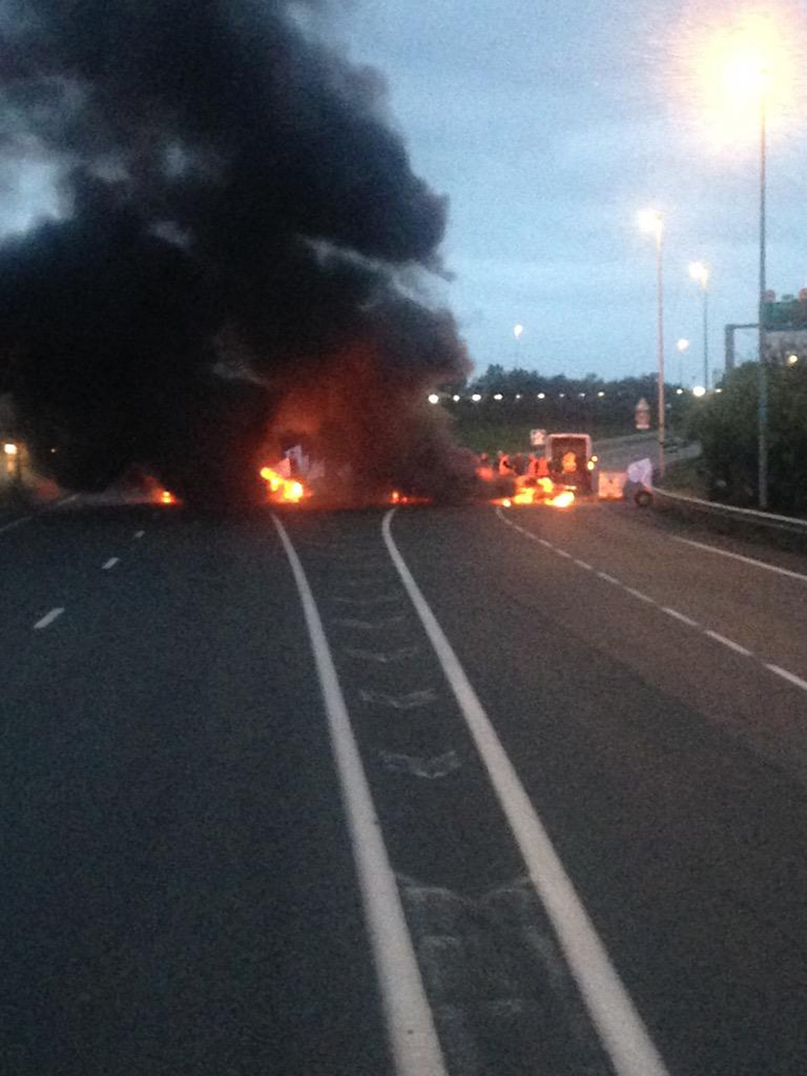 Burning blockade as French ferry workers strike in Calais. Picture from @chriscary180605