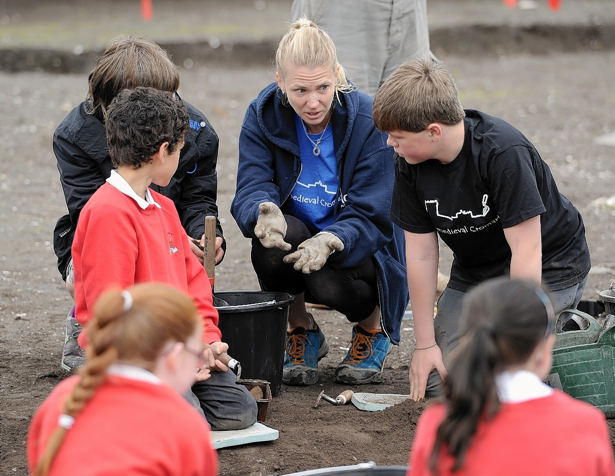 Pupils of Cromarty Primary School and Fortrose Academy at work on the Cromarty  archaeological dig in June 2015