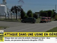 Emergency services at the scene outside a factory where a man was allegedly beheaded, in Saint-Quentin-Fallavier, France