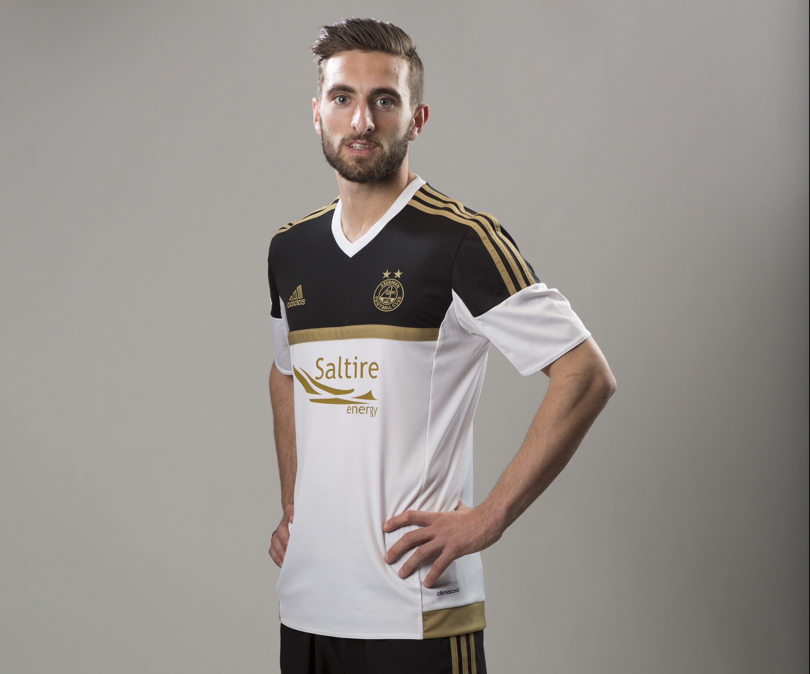 Graeme Shinnie poses in the Dons new away strip