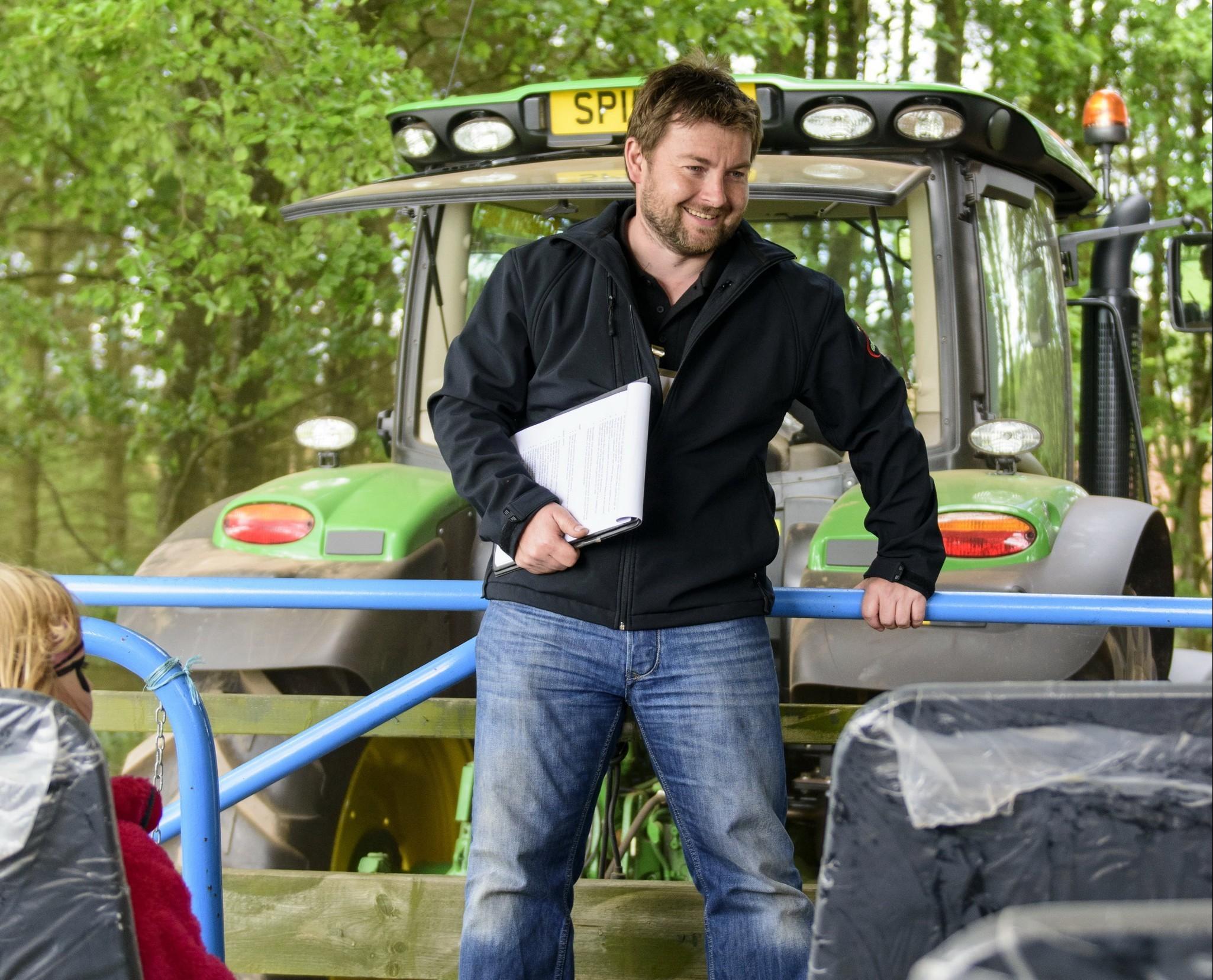 Ross Mitchell takes vistors on a tractor tour of Castleton Fruit Farm