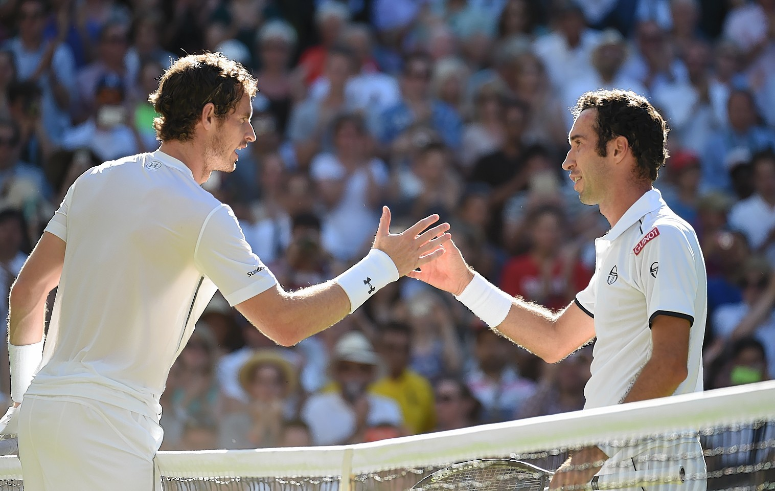Andy Murray shakes hands with Mikhail Kukushkin after defeating him by three straight sets.