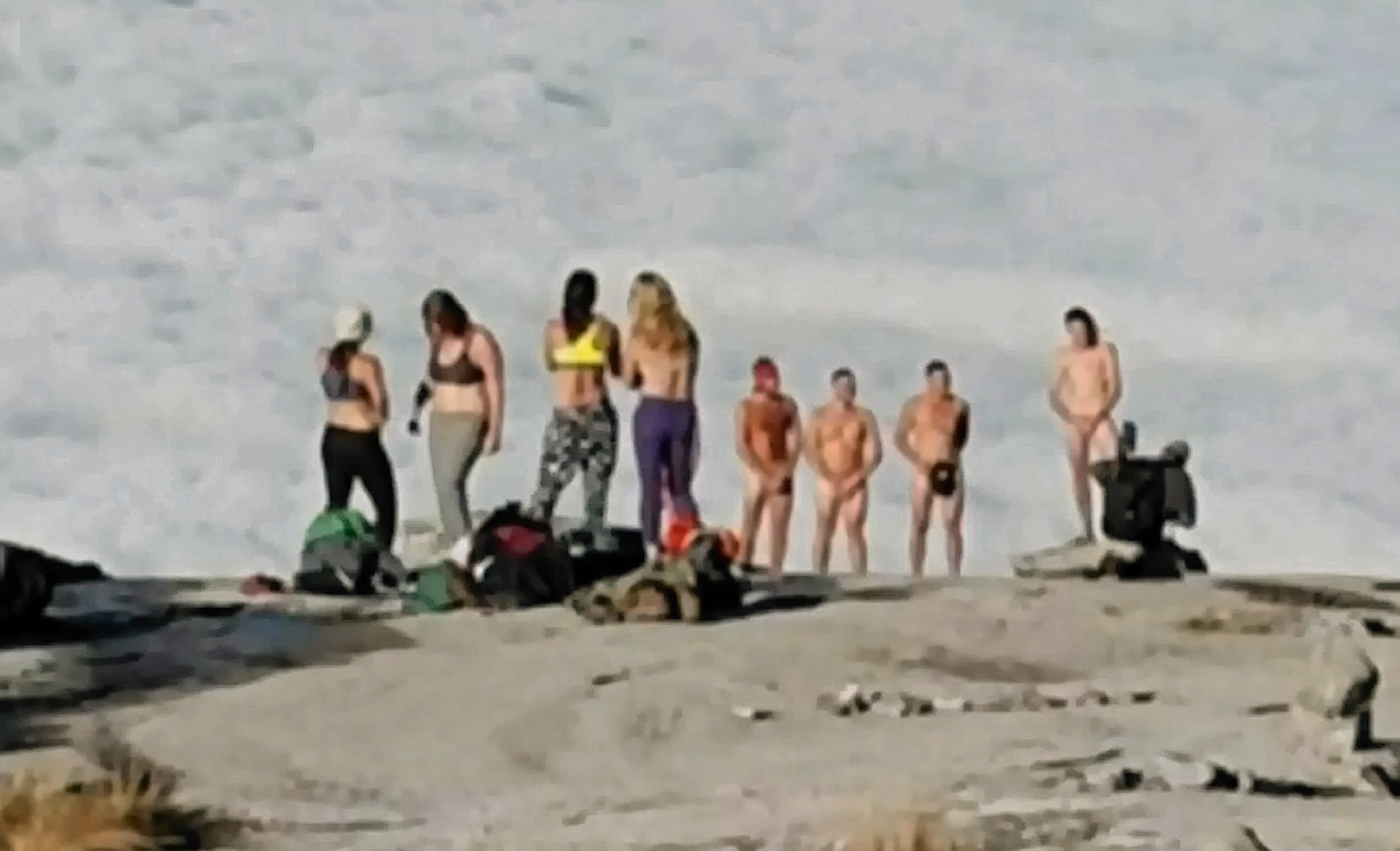 The group of tourists allegedly stripped naked before taking pictures on a mountain peak.