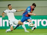 Aaron Doran is challenged by Astra's Pedro Oueilros.