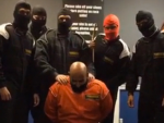 The HSBC workers were dressed in overalls and balaclavas at a go-karting centre when they staged a beheading scene,