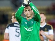 Aberdeen's Danny Ward applauds the Dons fans in Macedonia at full-time