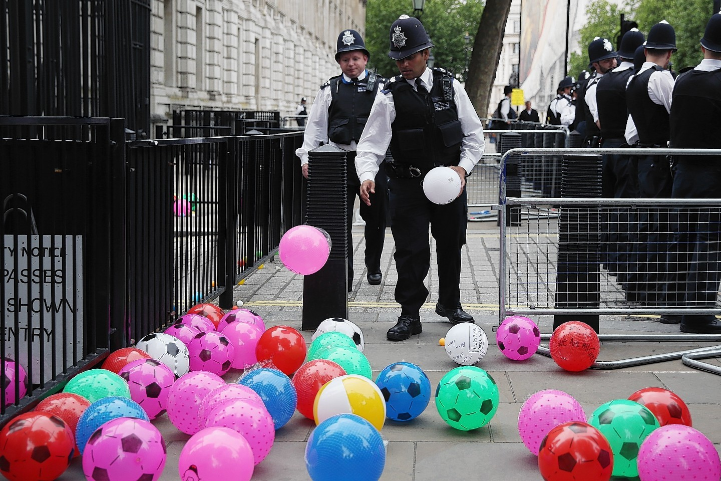 Anti austerity protesters throw balls towards Downing Street