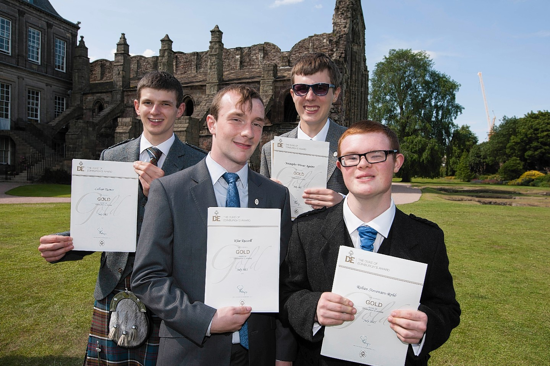 Callum Turner, Klae Russell, Christoper Winser Aguirre and ohan Stevenson-Robb with their gold Duke of Edinburgh awards