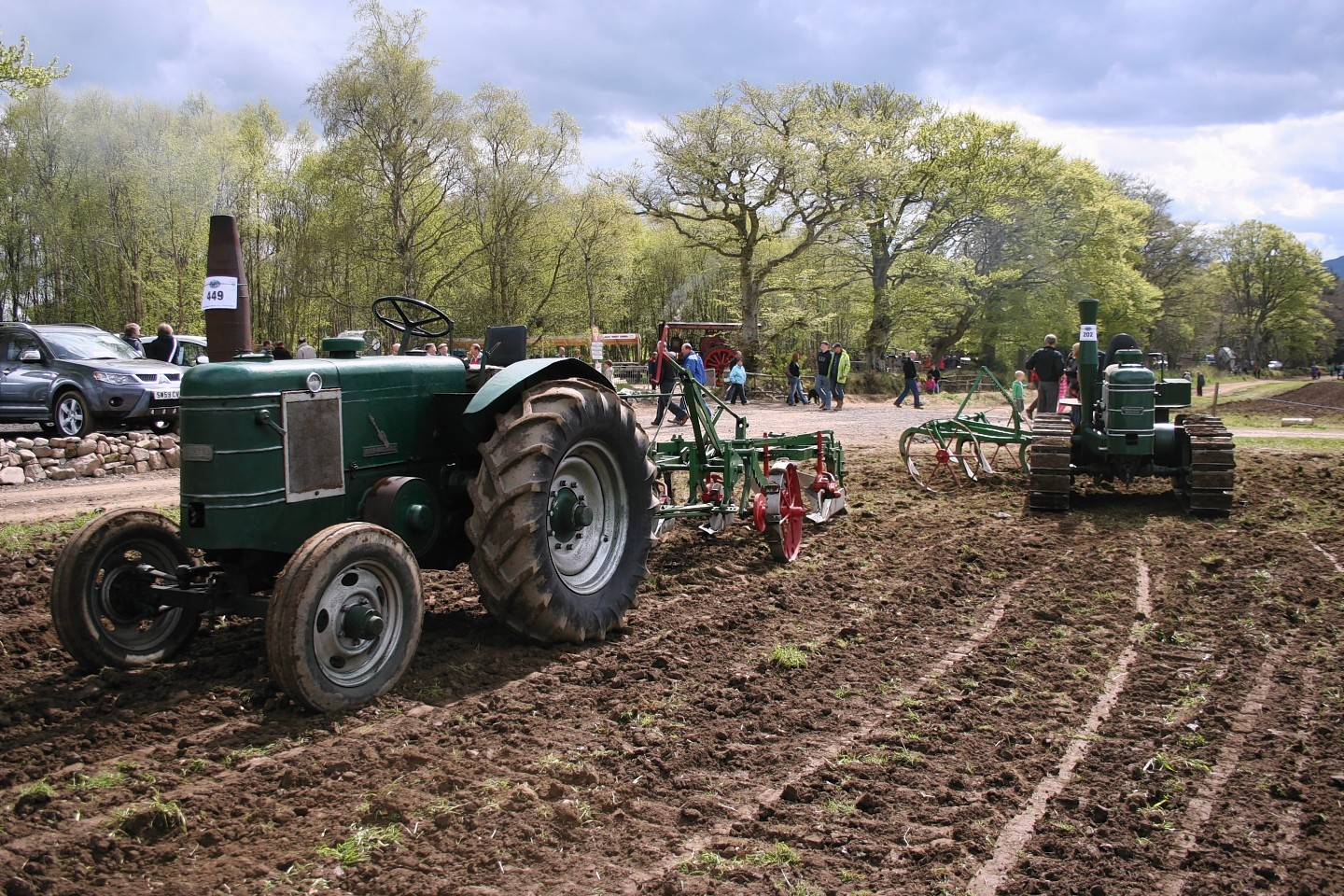 A Field Marshall Series 1 with cultivator in tow at a BA Stores event.