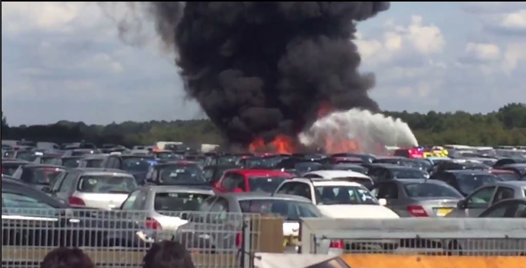 The plane crashed into a car auction
