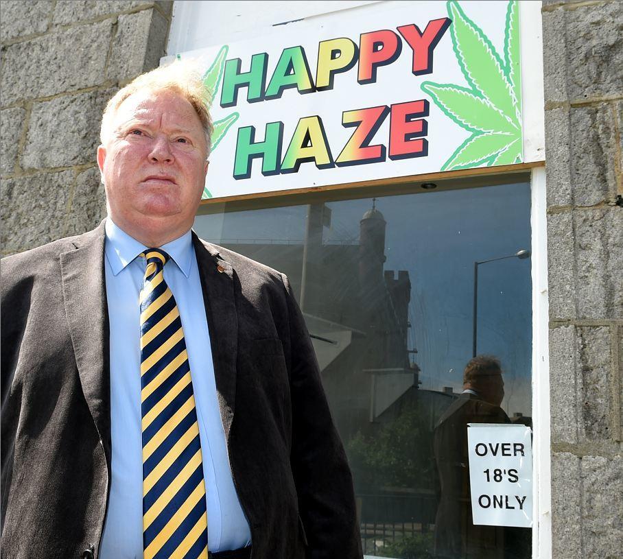 Councillor Bill Cormie outside the new Happy Haze shop
