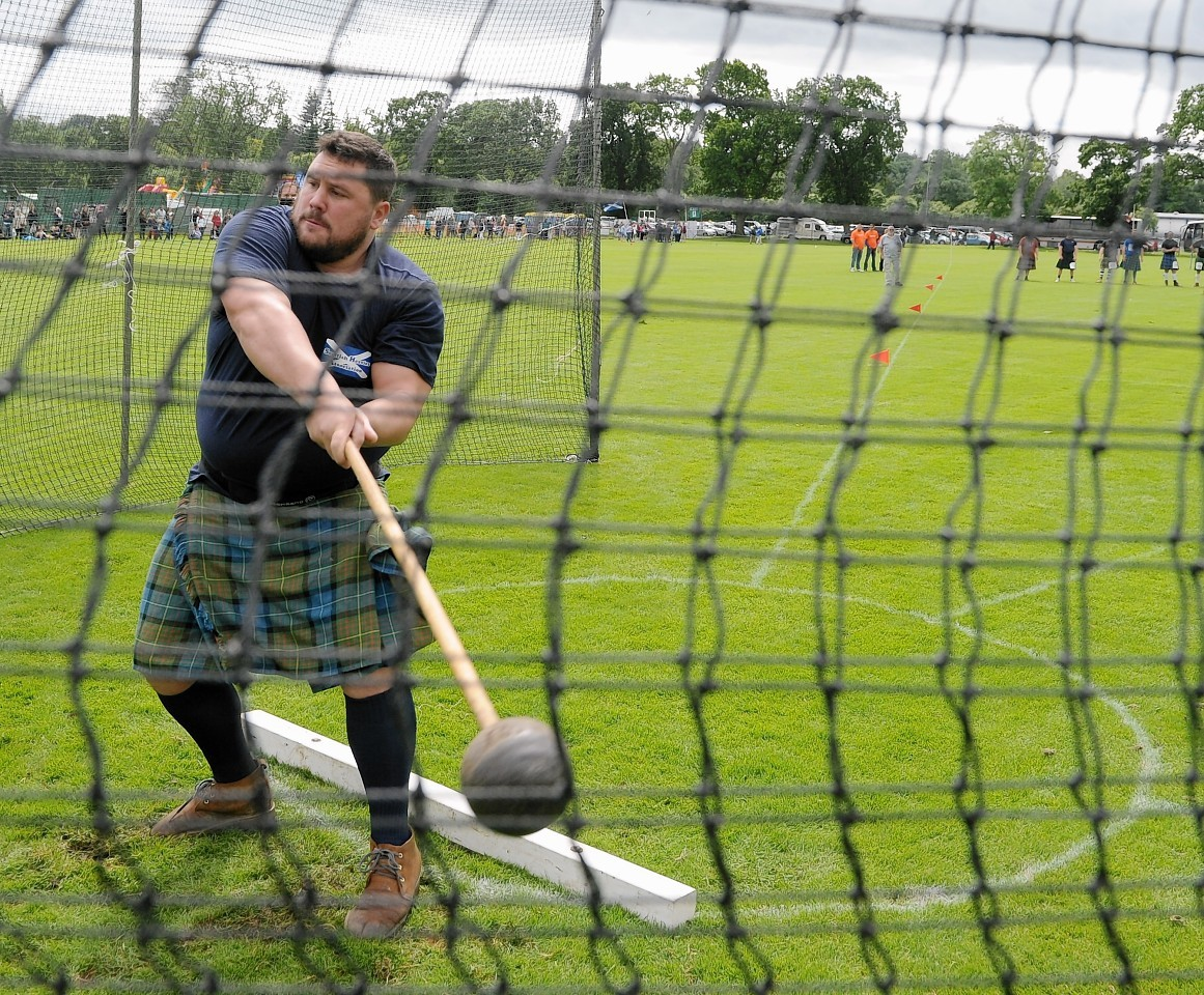 Sinclair Patience of Avoch throws the Scots Hammer.