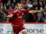 McGinn celebrates netting against Rijeka
