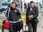 Derek McInnes (right) and assistant manager Tony Docherty arrive at Aberdeen airport as they prepare to travel to Macedonia