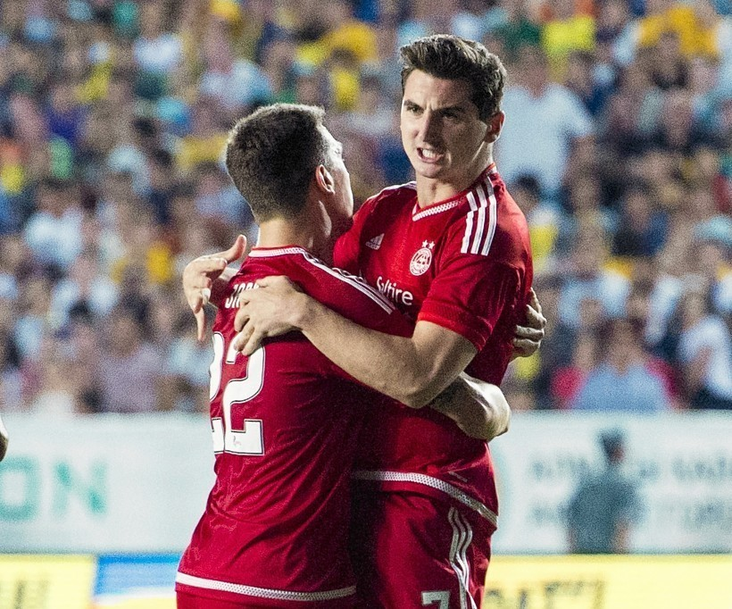 Kenny McLean celebrates his goal with Dons captain Ryan Jack