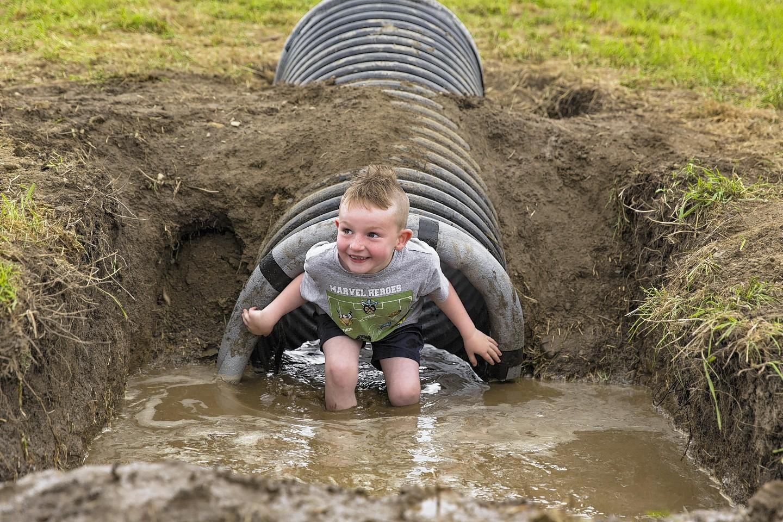 Liam Simpson, six, enjoying the water chute