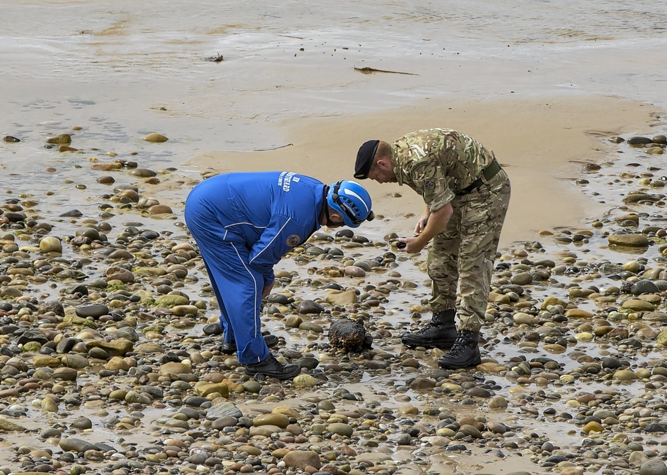 The Royal Navy Bomb Disposal team  from Faslane Northern Diving Group and the coastguard examine the bomb