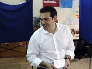 Greece's Prime Minister Alexis Tsipras casts his vote at a polling station in Athens (AP)