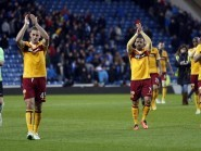Louis Laing, second left, aims to build on Motherwell's triumph over Rangers