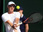 Jamie Murray in doubles action on Monday at Wimbledon