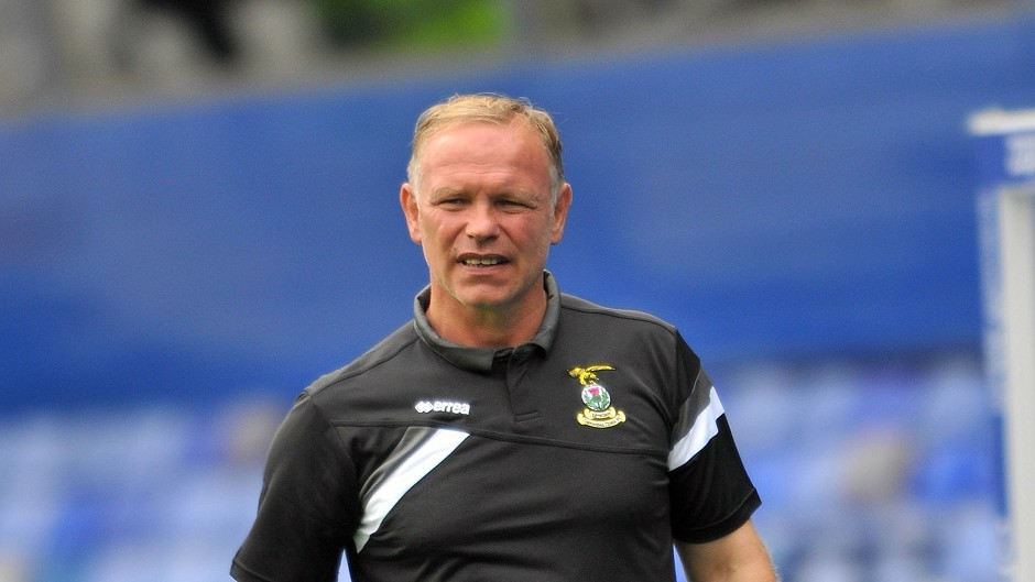 John Hughes had a brief spell in charge at Livingston in 2012.