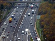 A motorway was closed as police tried to help a distressed woman on a bridge