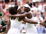 Serena Williams, left, dumped sister Venus out of Wimbledon's last 16 on Monday