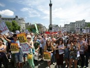Protesters take part in a demonstration by the Greek Solidarity Campaign in Trafalgar Square