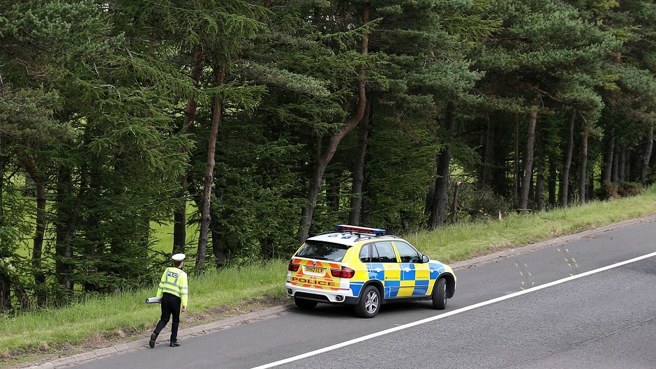A police car near to the site of the crash on junction 9 of the M9 which resulted in the deaths of John Yuill and Lamara Bell
