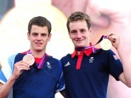 Jonny Brownlee, left, has been ruled out until September with a stress fracture of his femur