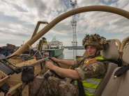 Trooper David Pratt, serving with the Royal Scots Dragoon Guards, driving a Jackal armoured vehicle which will now be part of his unit's equipment (MoD/PA)