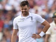 James Anderson walks off the field after hurting his side at Edgbaston