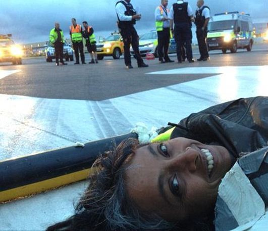 'Plane Stupid' selfie - protesters take pictures on the runway