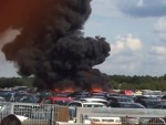 Thick black smoke is blown across the sky following the crash