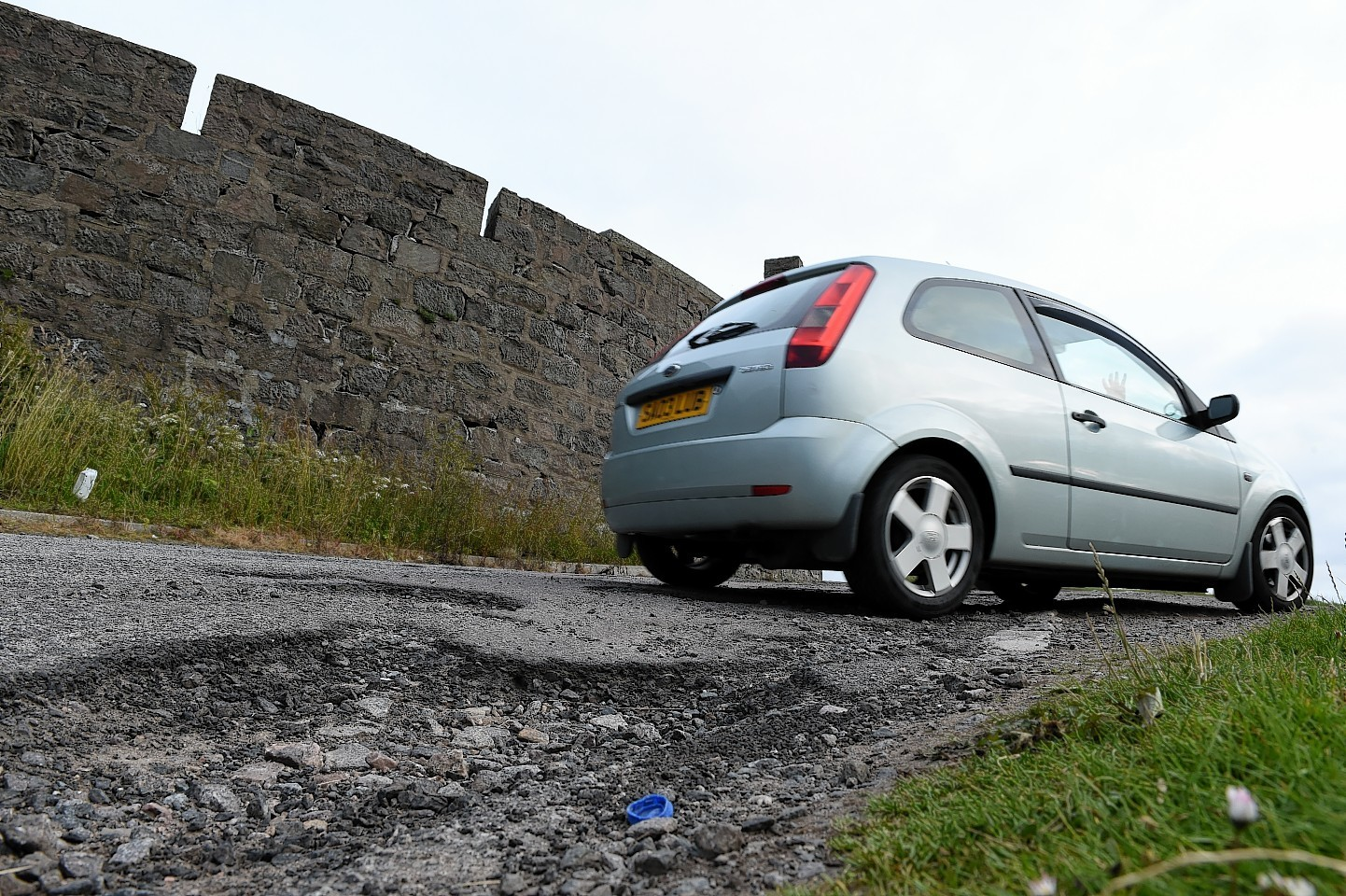 Potholes at Nigg car park. Picture by Kevin Emslie