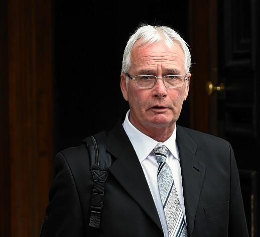 Robert Rae leaving court