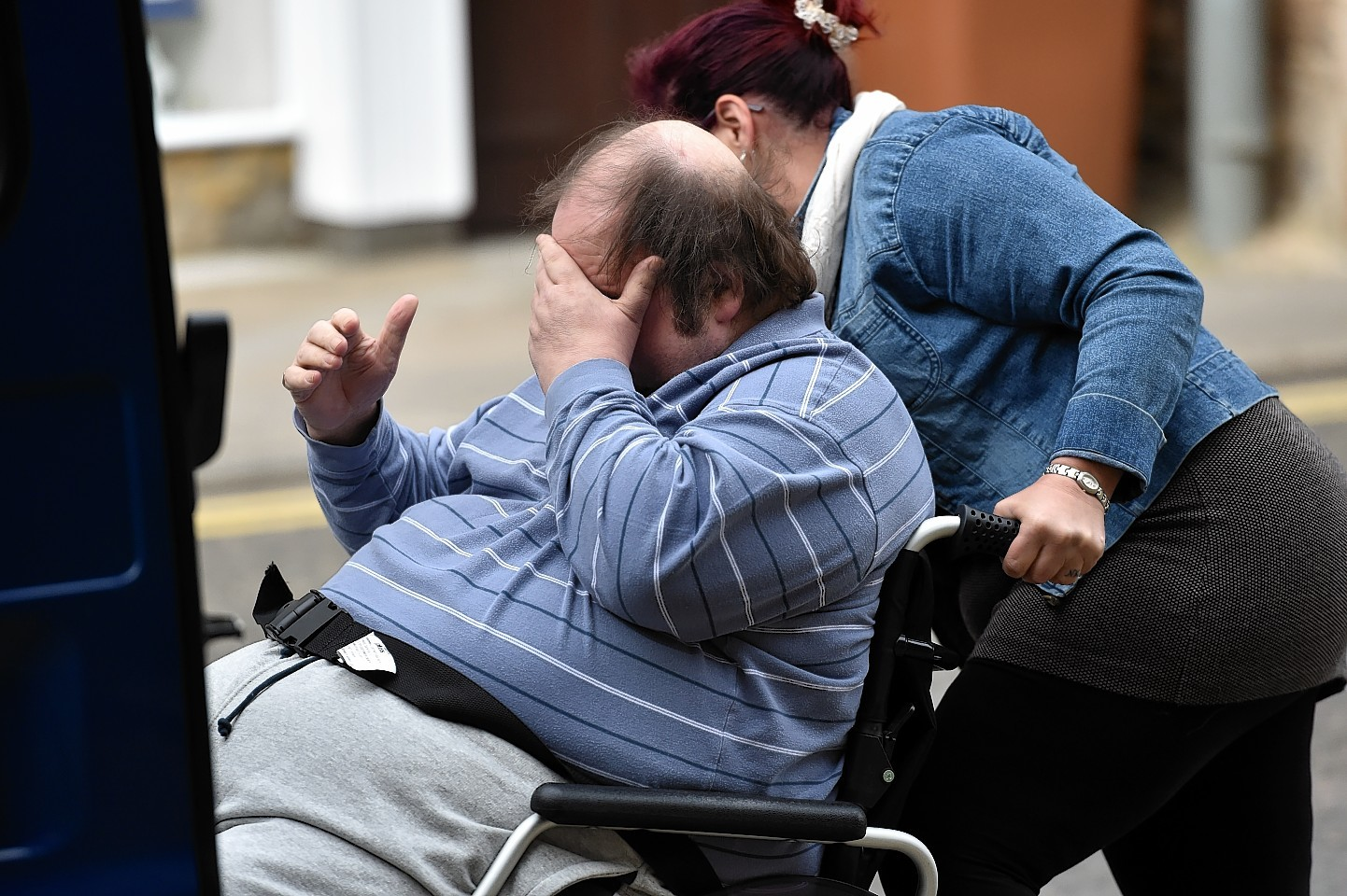 Stanley Sandison is wheeled from the High Court in Elgin.