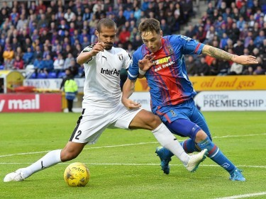 Tansey fights for the ball against Astra