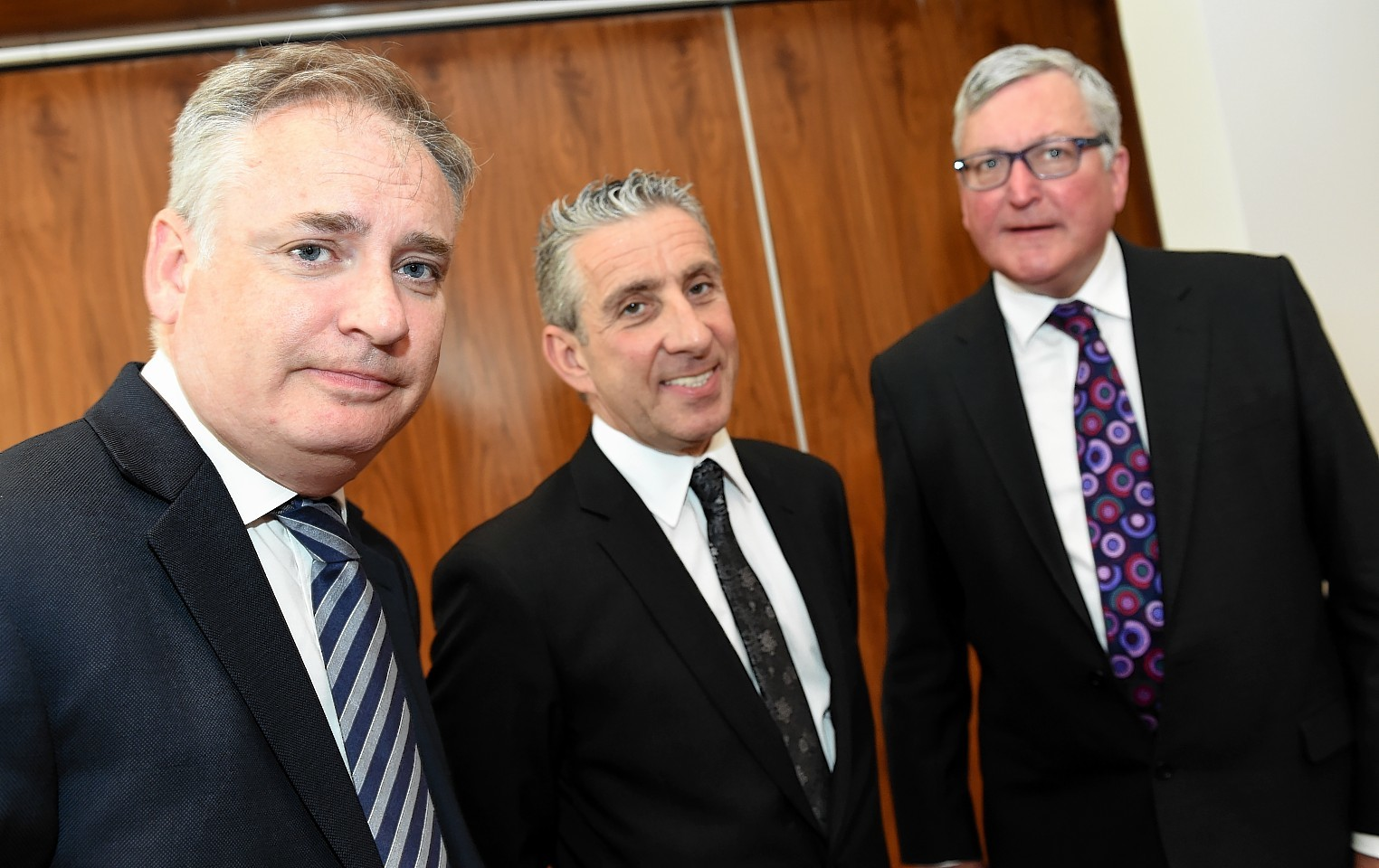 Young's boss Pete Ward (centre) with Richard Lochhead MSP and Fergus Ewing MSP.