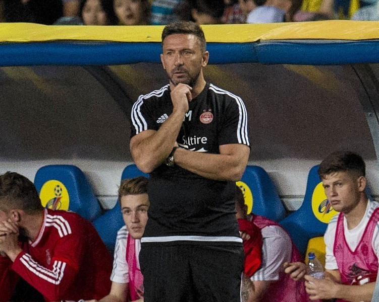 Aberdeen manager Derek McInnes in the dugout in Almaty.