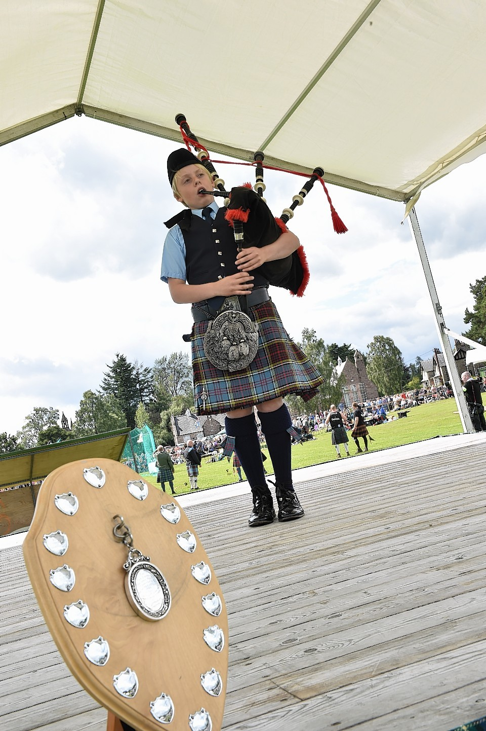 Aboyne Highland Games - Piper Liam Brown, 11, from Johnshaven won the under 14 March. Picture by COLIN RENNIE